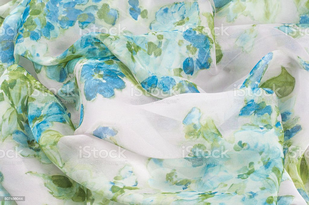 Silk fabric texture, background, painted white with blue flowers stock photo