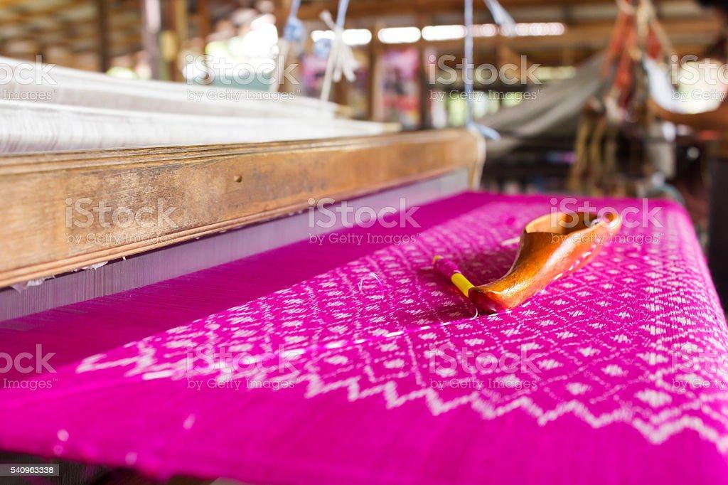 Silk loom. Traditional weaving of Thai silk. stock photo