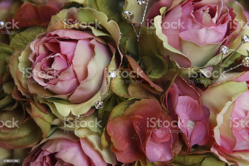 Silk roses in a bouquet royalty-free stock photo
