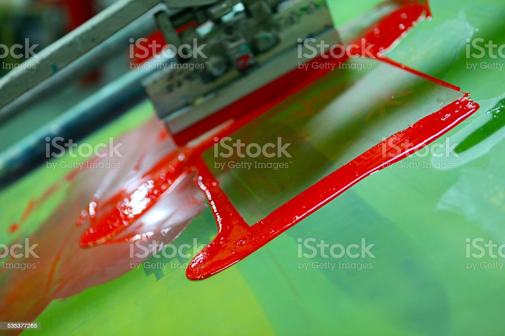 Silk screen printing detail, with red ink stock photo