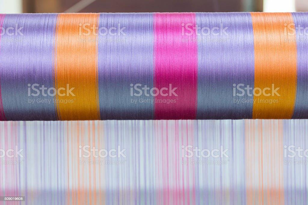 Silk weaving stock photo