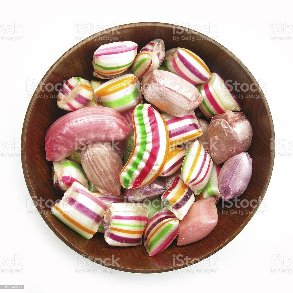 Silky candies in wooden dish royalty-free stock photo