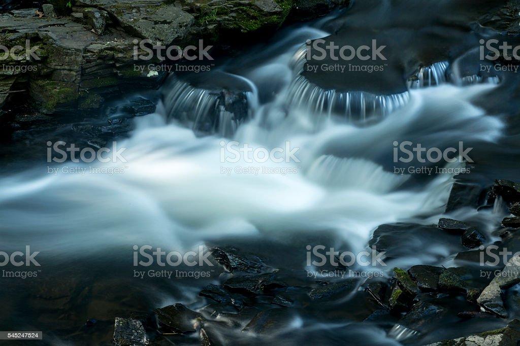 Silky water in rapids of Hockanum River, Rockville, Connecticut. stock photo