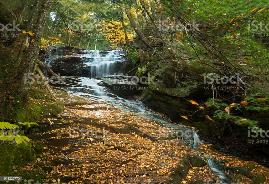 Silky waters of Tama Falls in New Hampshire's White Mountains. stock photo