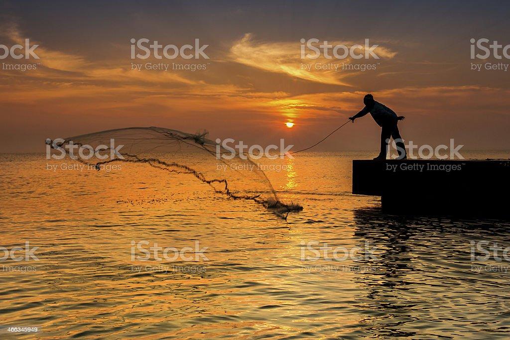 sillhouette fisherman and sunset on bridge royalty-free stock photo