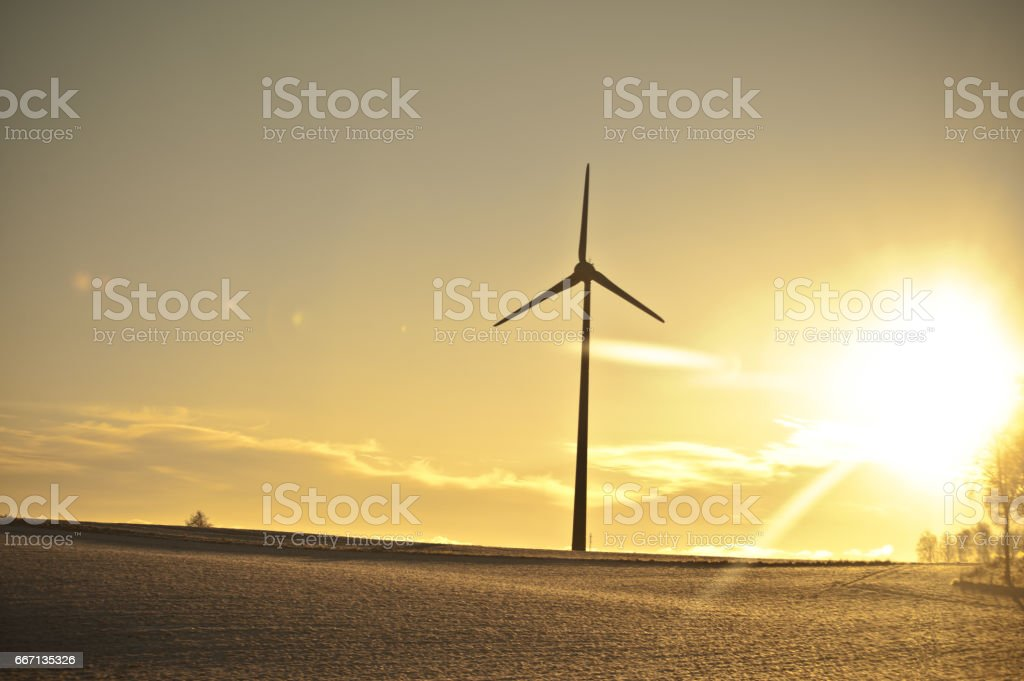 Sillhouette of a Wind Turbine On a Lovely Evening stock photo