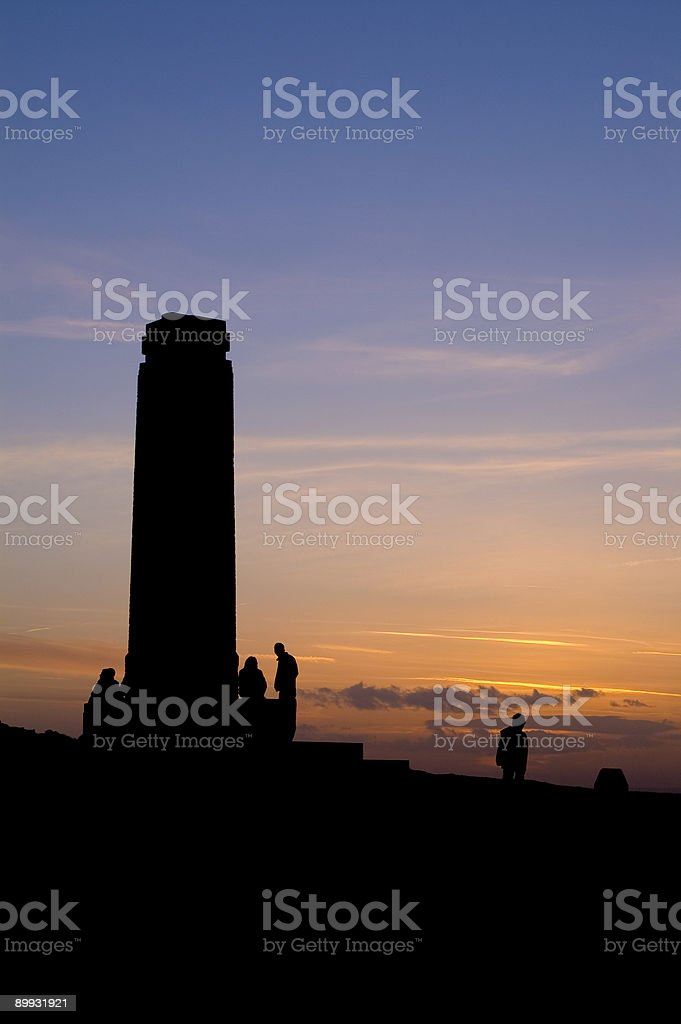 Sillhouette of monument and figures at sunset royalty-free stock photo