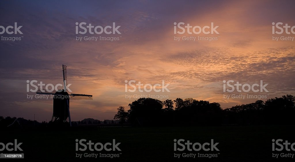 Sillhouette of windmill by Sunrise in Holland stock photo