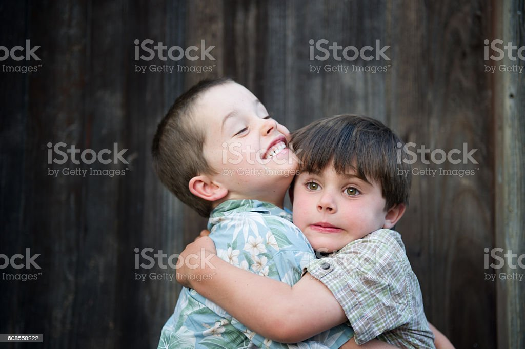 Silly brothers hugging and being funny stock photo