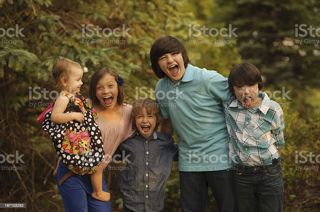 Silly Children Having Fun Outside stock photo