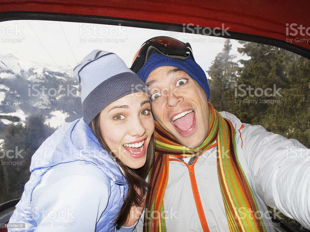 Silly couple laughing in ski lift royalty-free stock photo