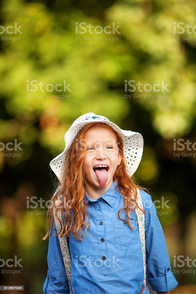 Silly little red-haired girl stock photo