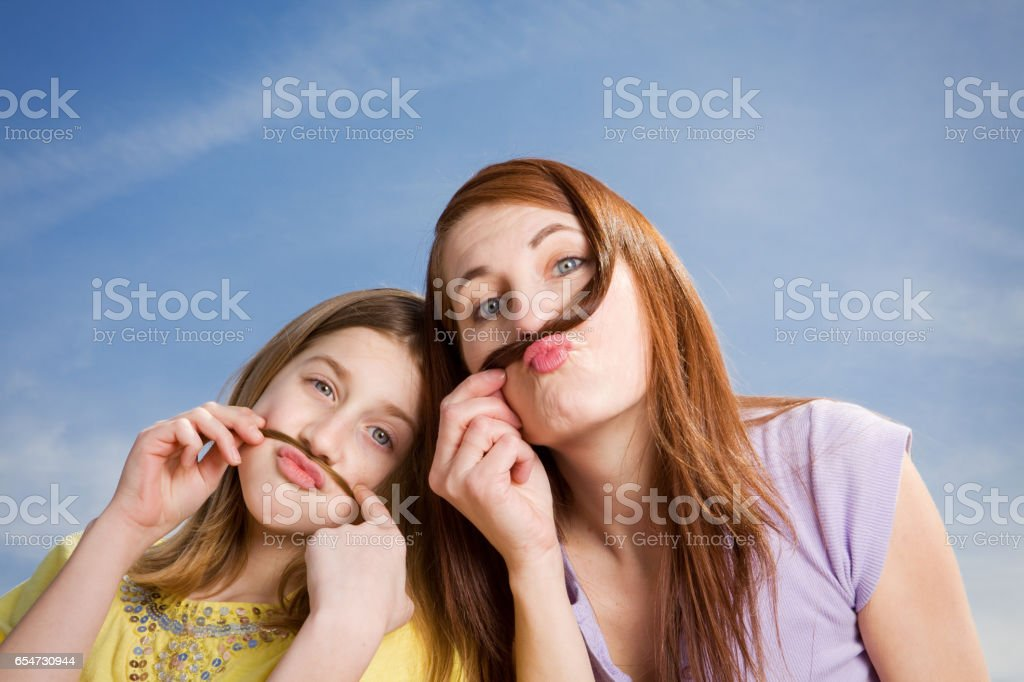 Silly Mother And Daughter stock photo