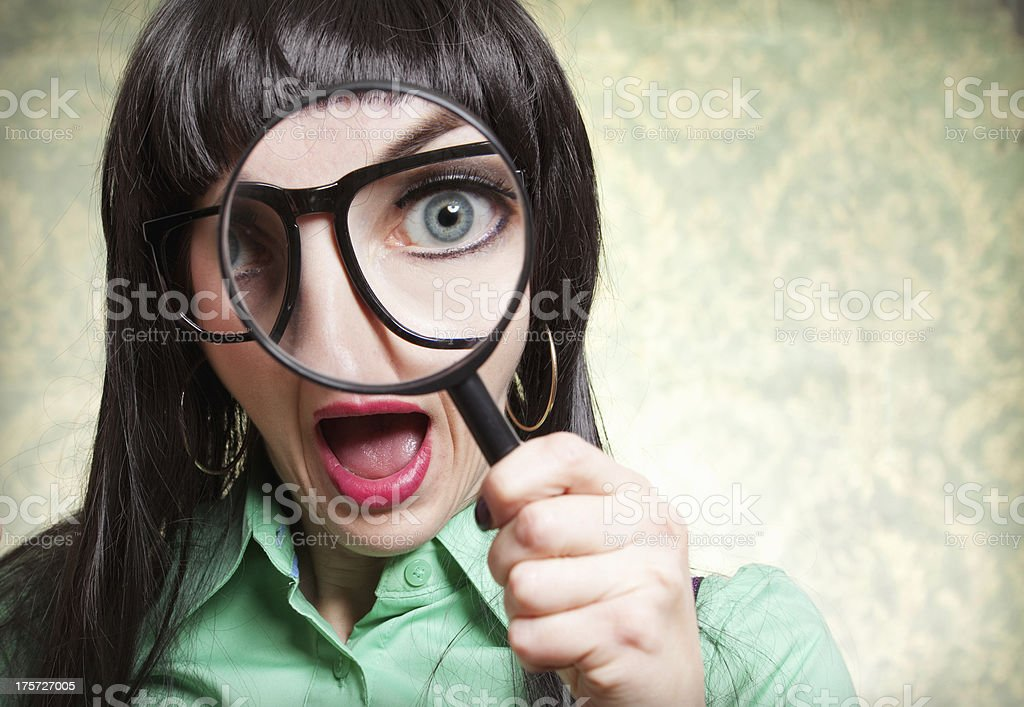 Silly Nerd Woman Looking Through Magnifying Glass royalty-free stock photo