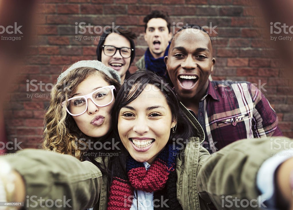 Silly selfies for five fun young people stock photo