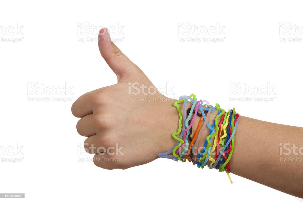 Silly Shaped Rubber Band Bracelets,  Child Hand With Thumbs Up royalty-free stock photo