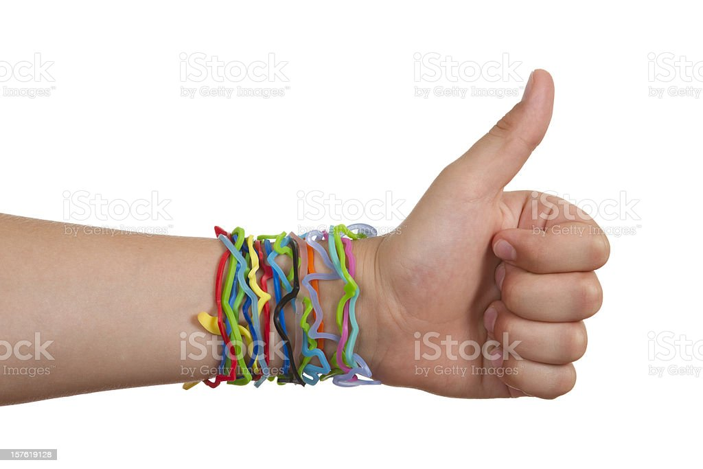Silly Shaped Rubber Band Bracelets, Hand With Thumbs-Up royalty-free stock photo