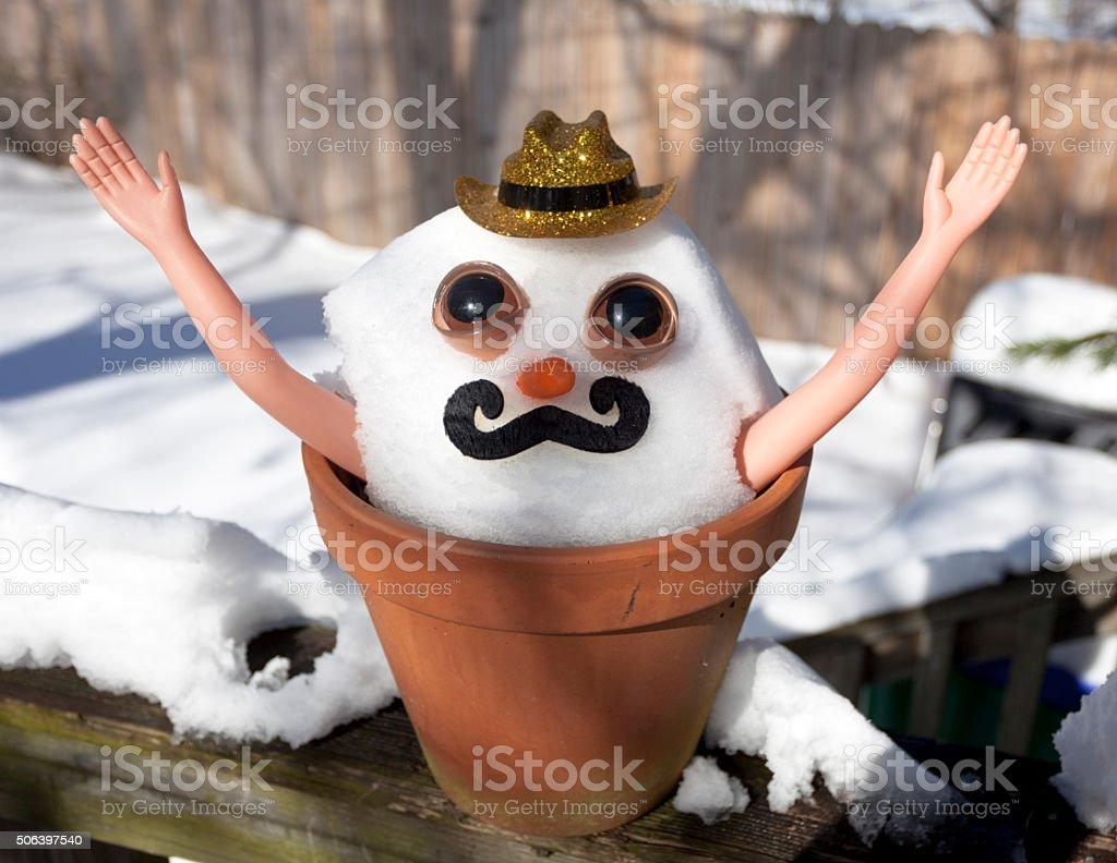 Silly Snowman Pleading for Sun stock photo