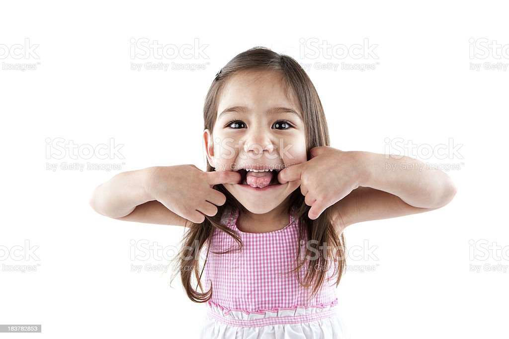 silly young girl sticking tounge out royalty-free stock photo