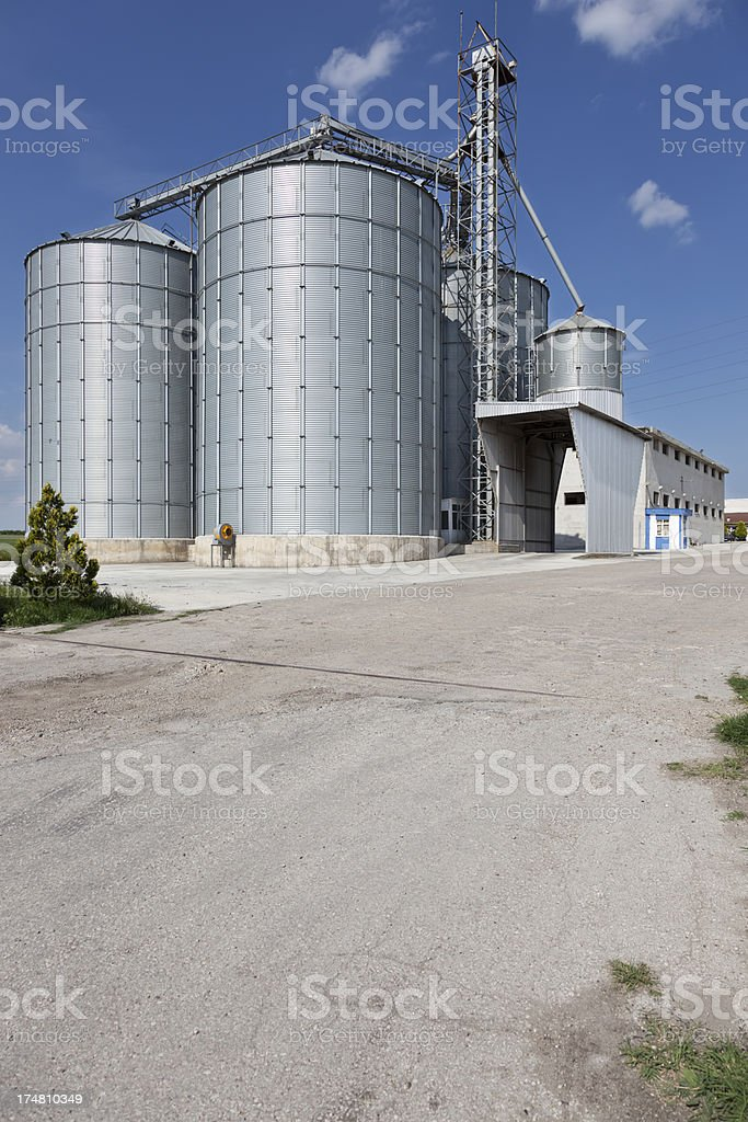 Silo facility with blue sky royalty-free stock photo