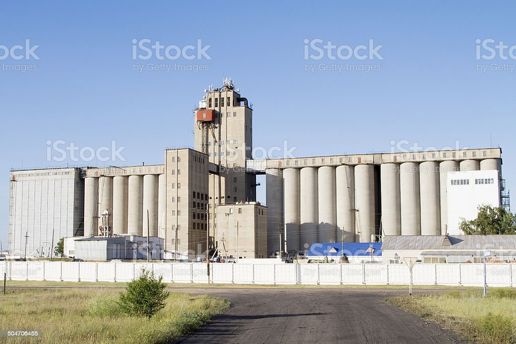Silo for storing and drying grain in the village stock photo