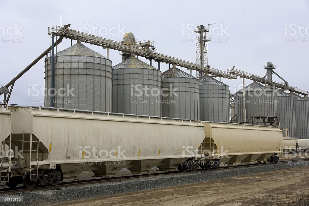 Silos and Agriculture Hopper Cars royalty-free stock photo