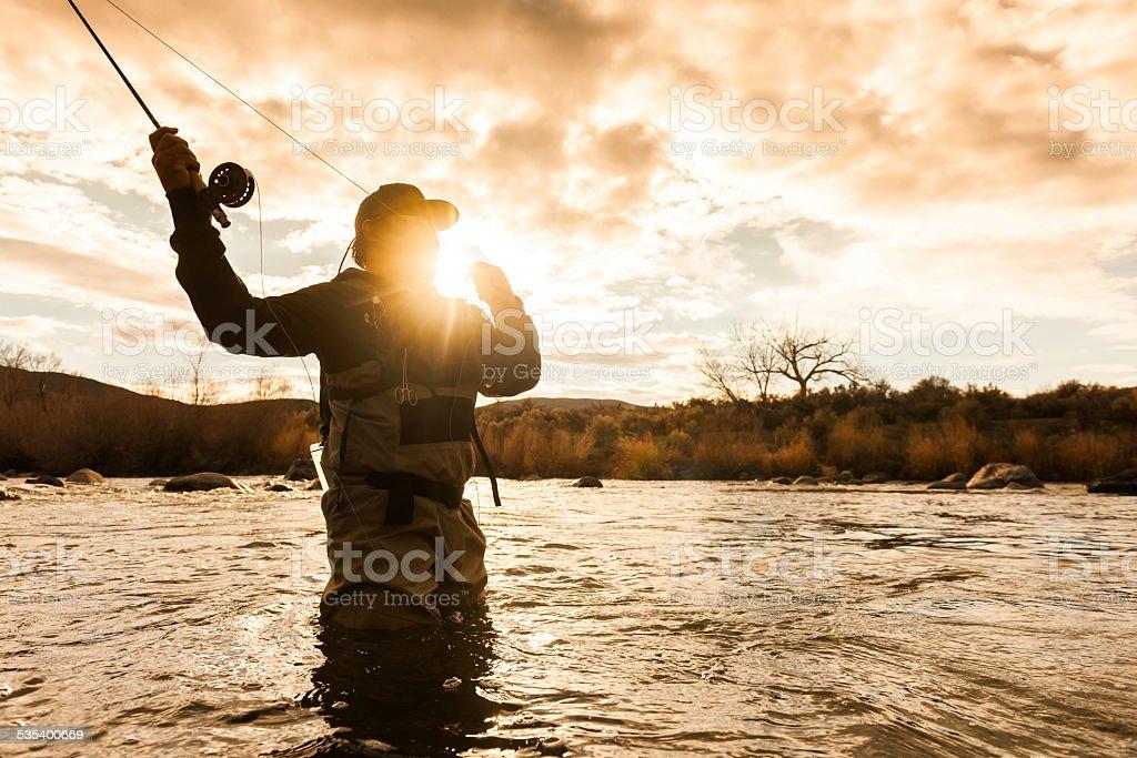 Silouette Fishermen stock photo