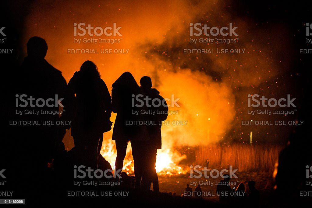 Silouette of people at the traditional Easter bonfire stock photo