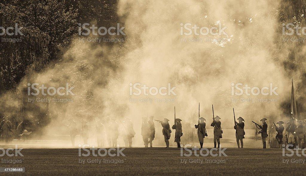silouettes in cannon smoke II stock photo