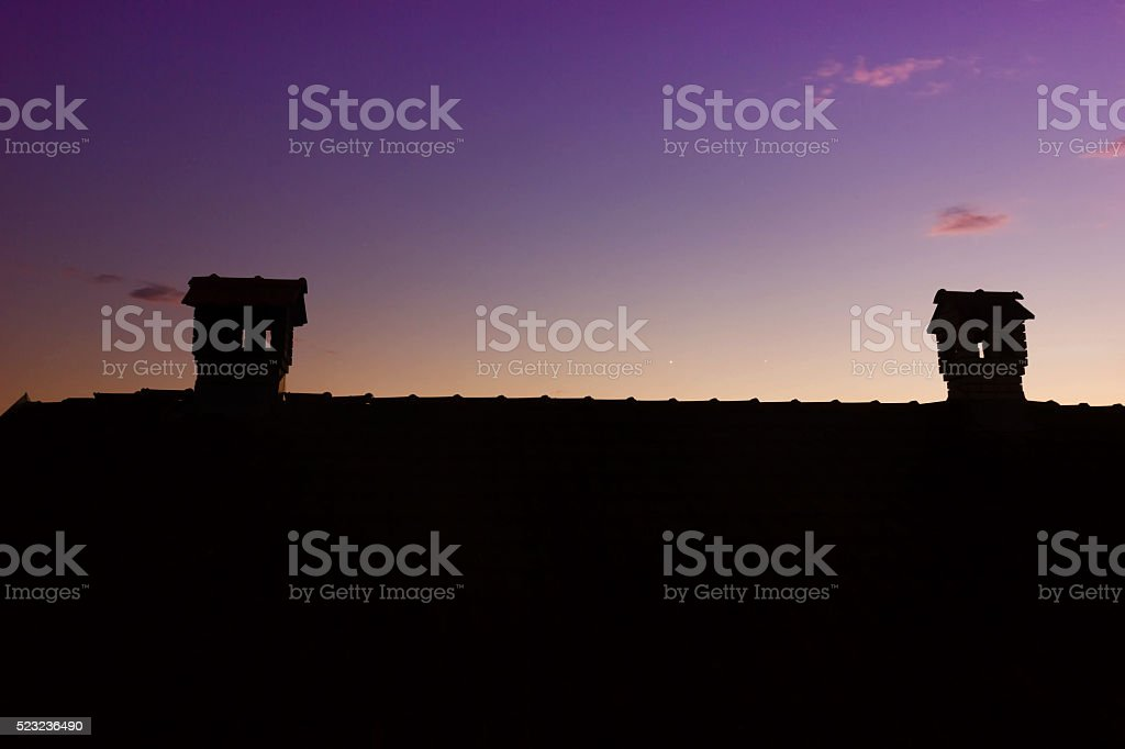 Silouhette of Chimney Like A Little House On The Roof stock photo