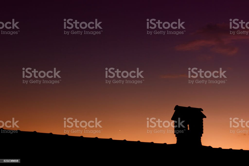 Silouhette of Chimney Like A Little House stock photo
