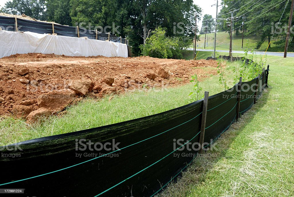 Silt fence erosion control at construction site stock photo