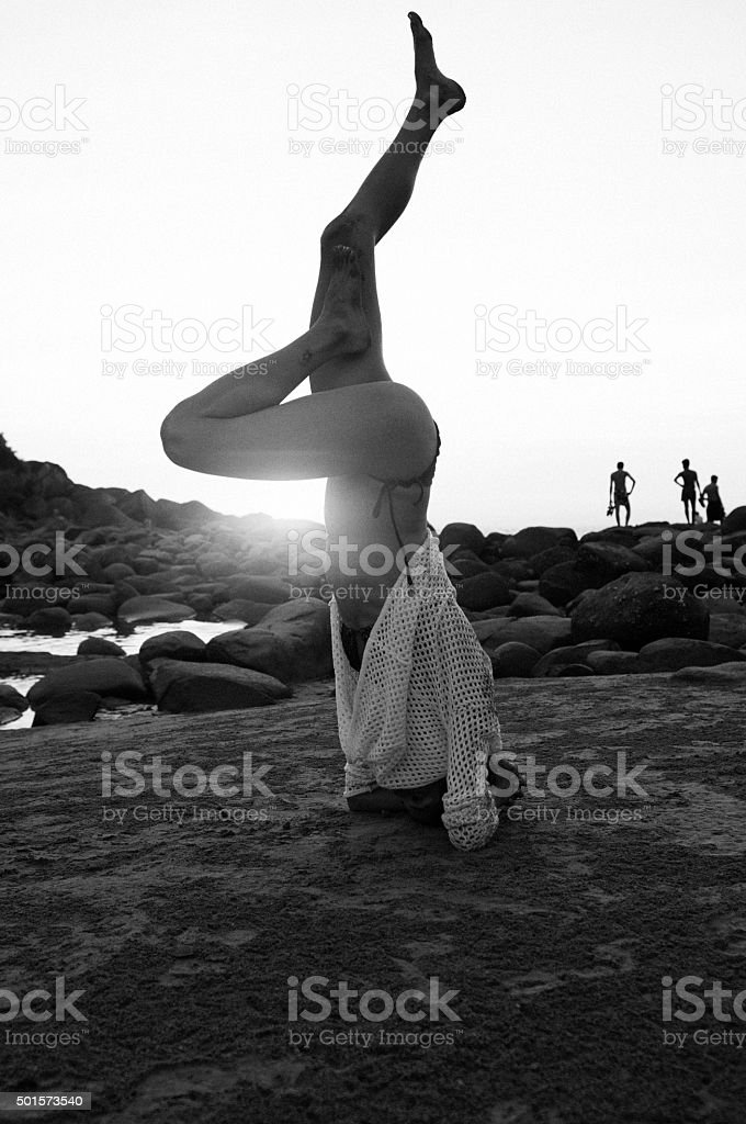 Siluet of woman doing yoga at the beach stock photo