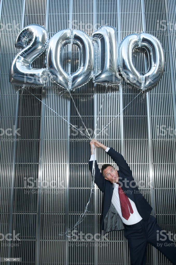 Silver 2010 Balloons Carry Businessman Away royalty-free stock photo