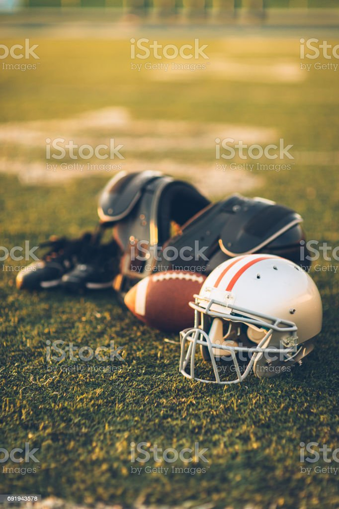 Silver American Football Helmet on Field stock photo