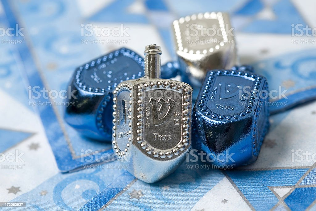 Silver and Blue dreidels stock photo