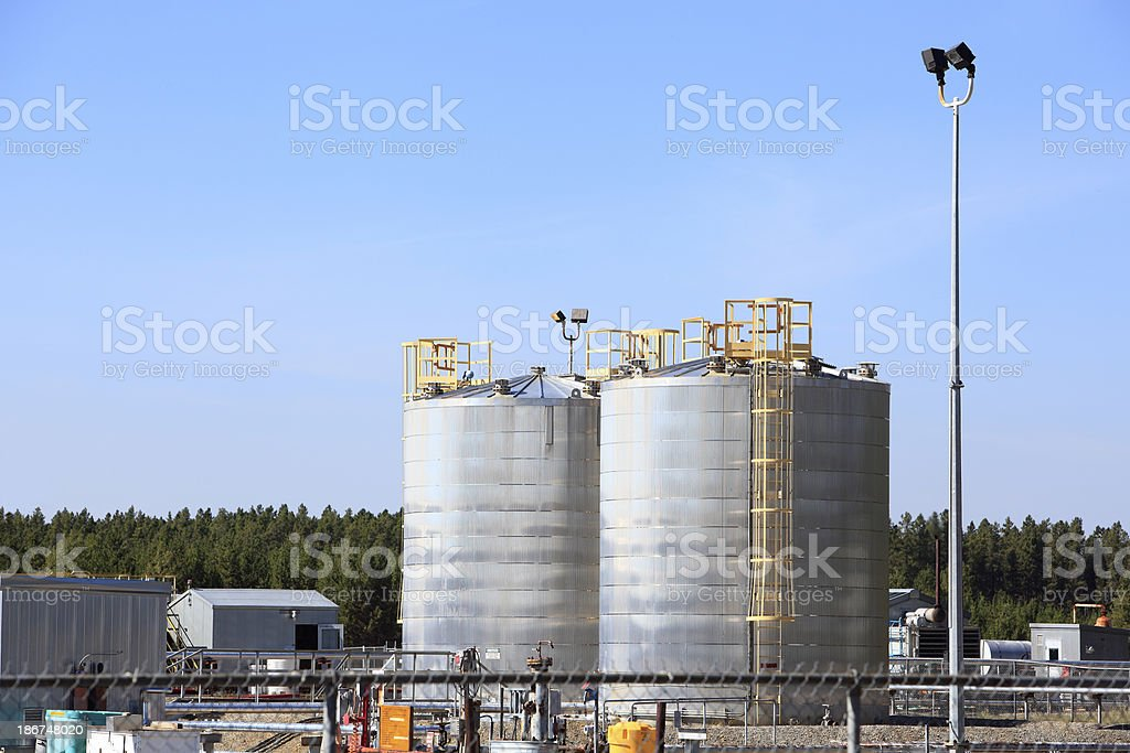 Silver And Gold Fuel Storage Tanks At Refinery royalty-free stock photo