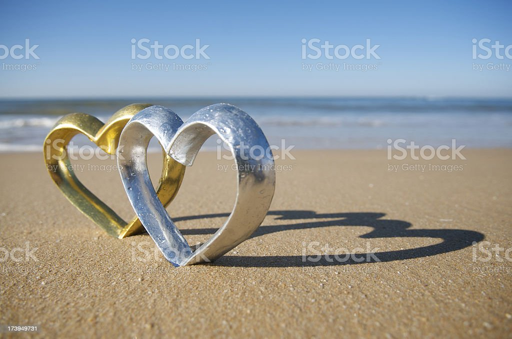 Silver and Gold Heart Shine on the Beach royalty-free stock photo