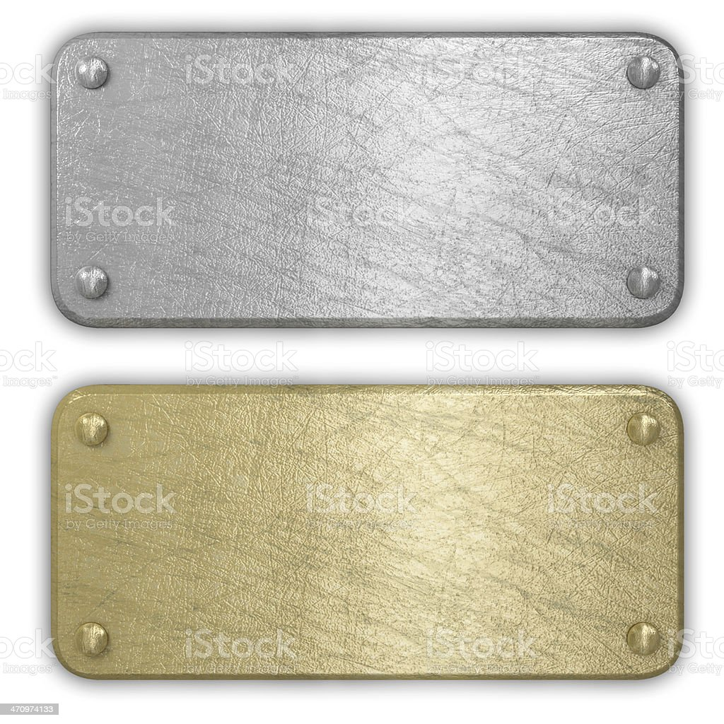 Silver and gold metal plates isolated stock photo