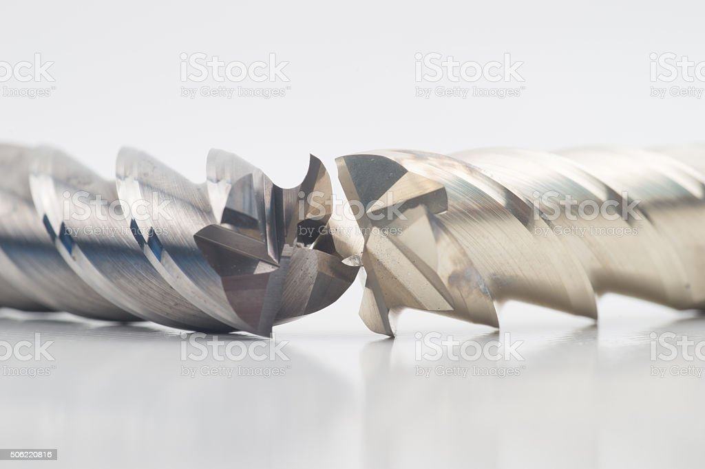 Silver and golden end mill cutter stock photo