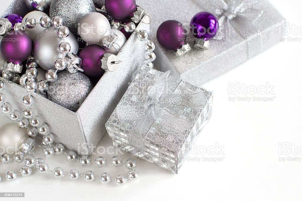Silver and purple Christmas ornaments border stock photo
