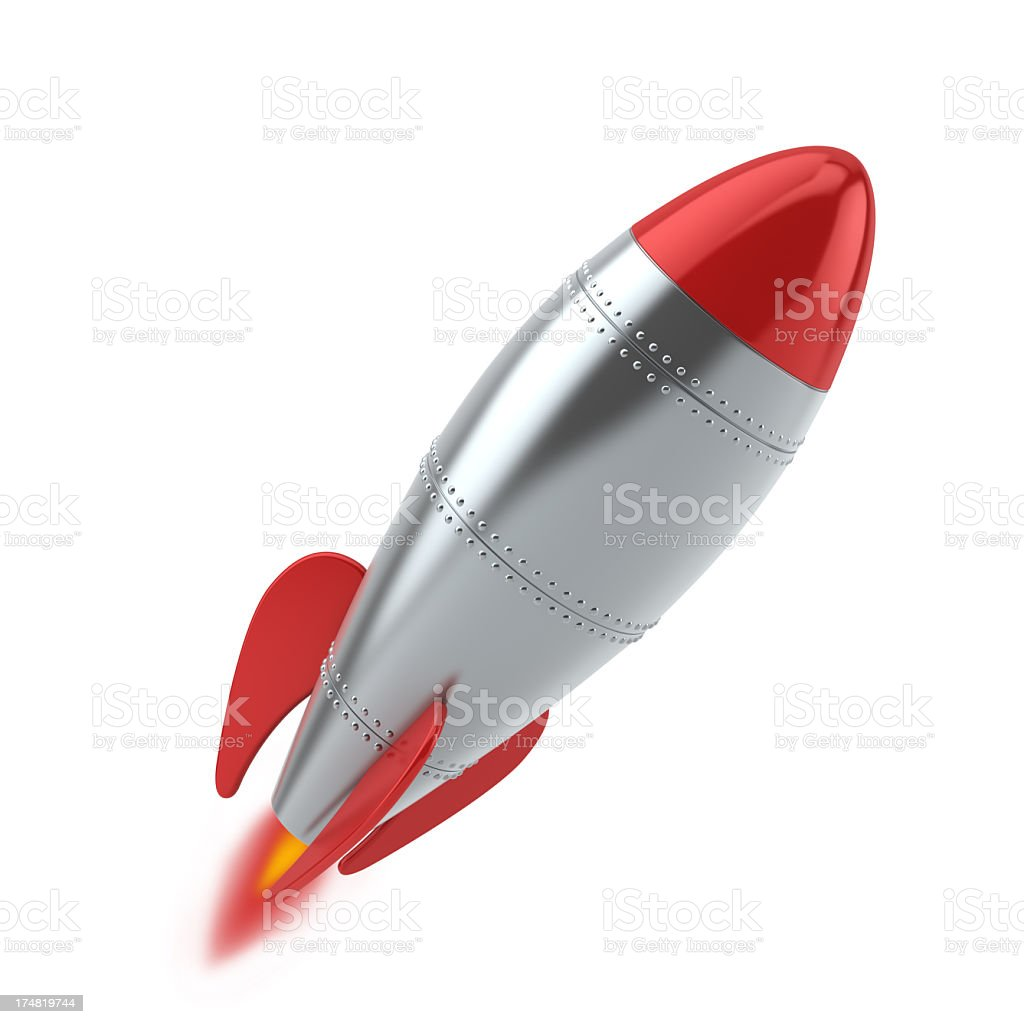 Silver and red rocket launching against white background stock photo