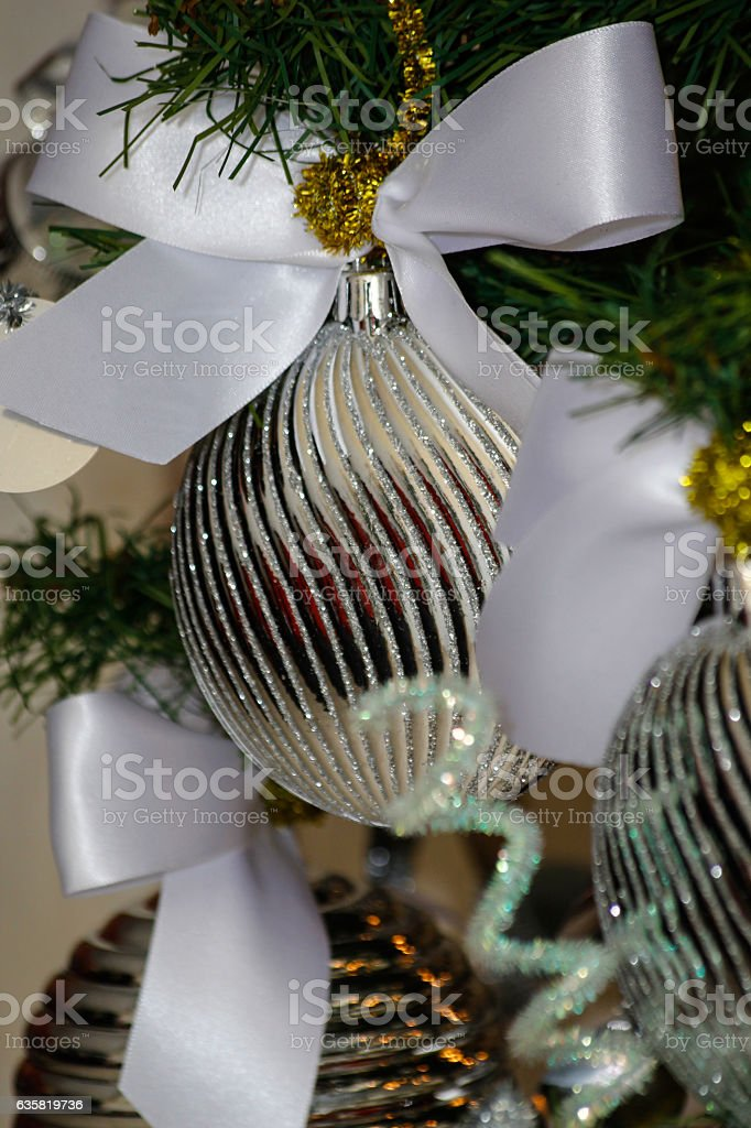 silver and white christmas tree decorations royalty free stock photo