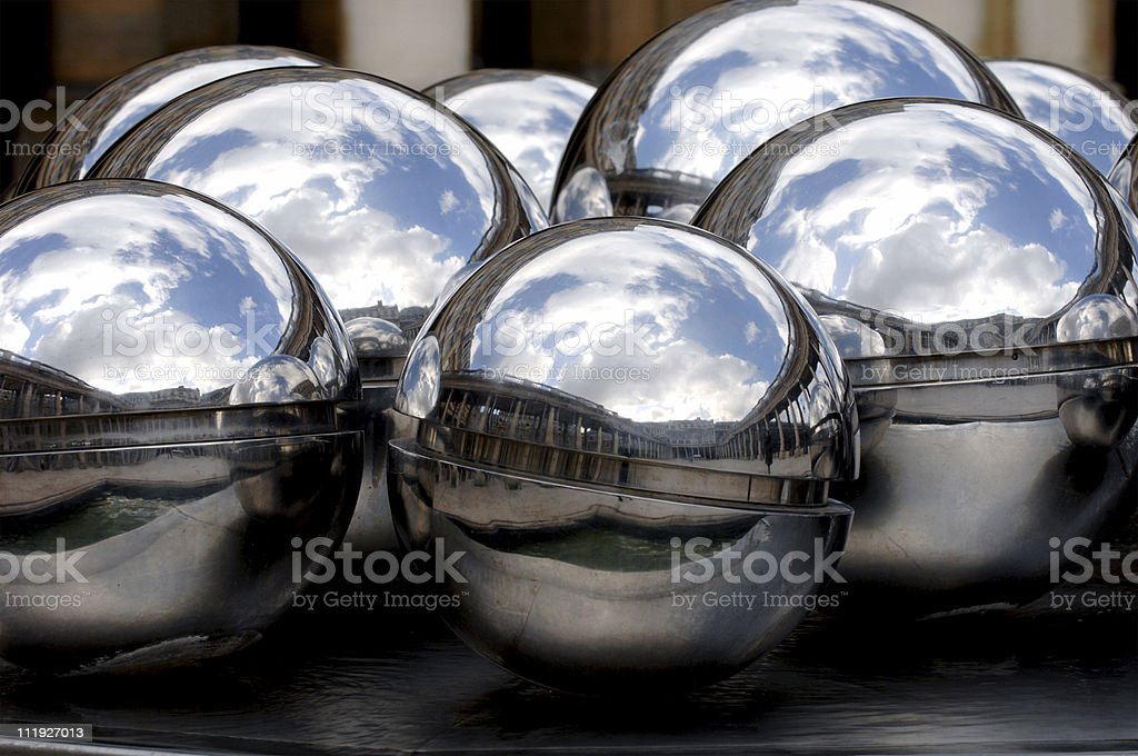 Silver ball fountain reflecting the Palais Royal in Paris France stock photo
