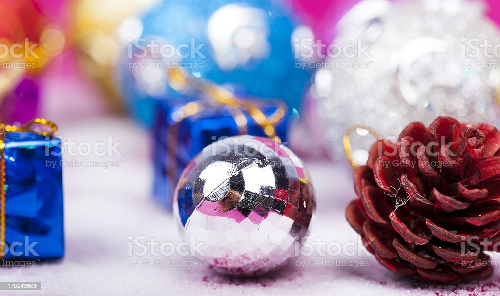 Silver ball with Christmas ornaments royalty-free stock photo