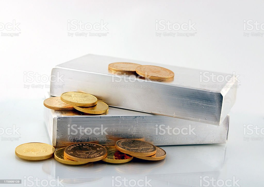 Silver Bars with Gold Coins. royalty-free stock photo