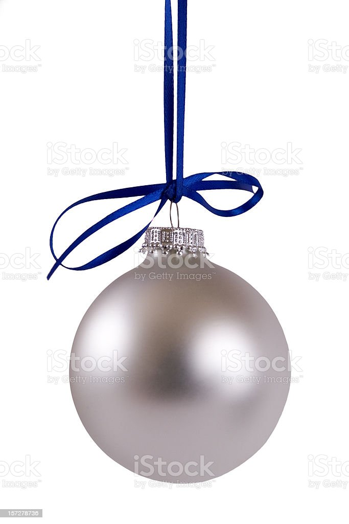 Silver bauble hanging from a blue ribbon royalty-free stock photo