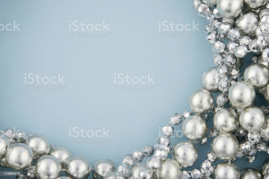 Silver Beads on Blue royalty-free stock photo