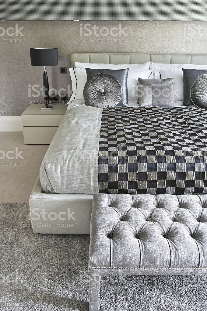 silver bed and footstool stock photo