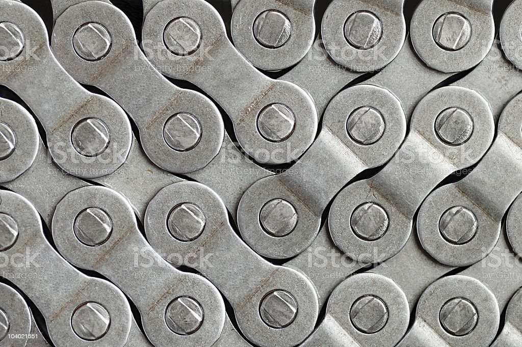 A silver bike chain that is tightly laid together  stock photo